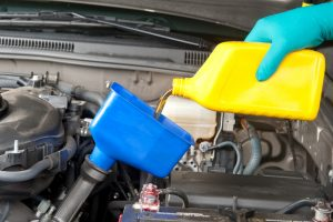 changing oil during car maintenance
